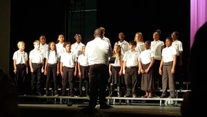 The choir all practicing and led by Mr. Xavier Moses.
