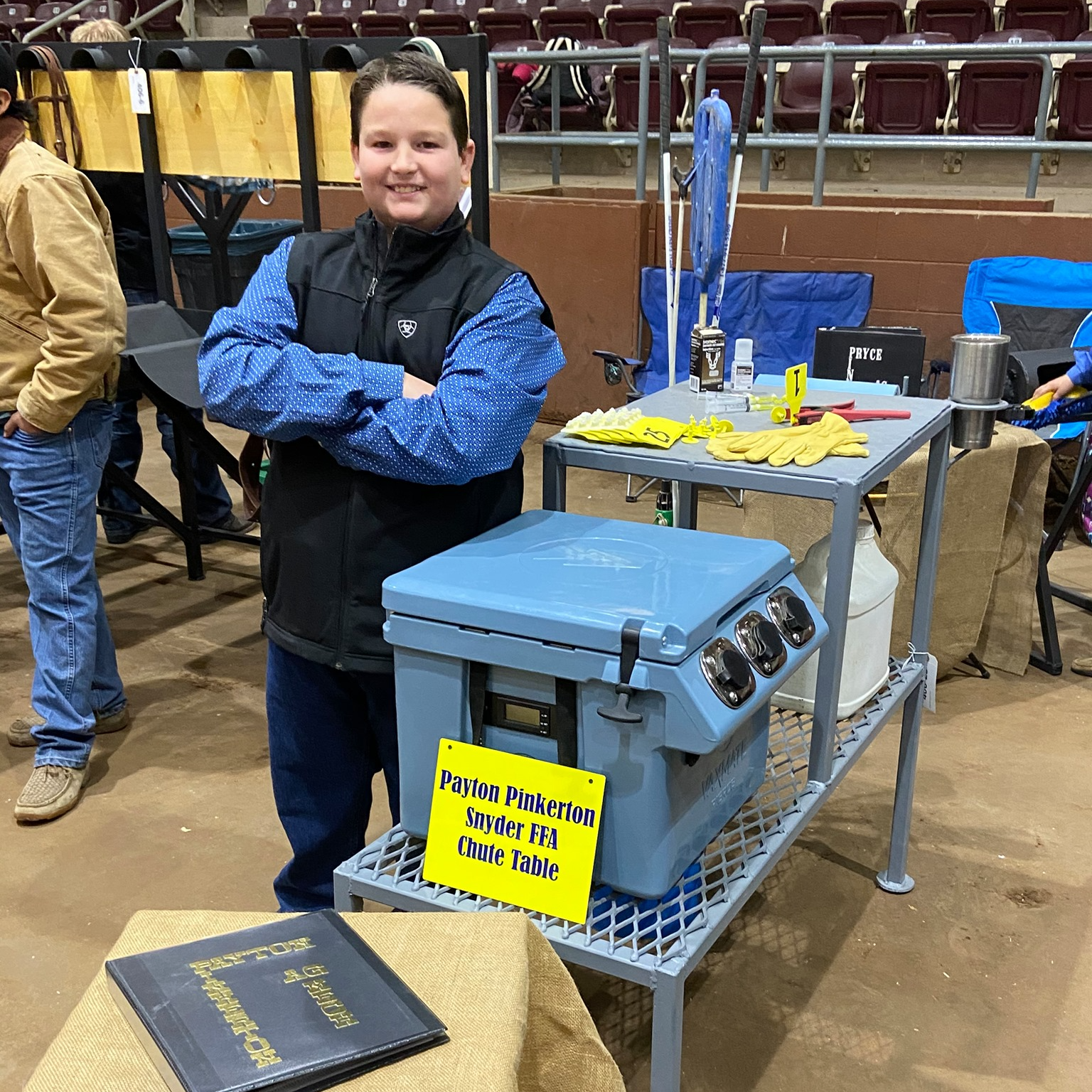 FFA student standing by table