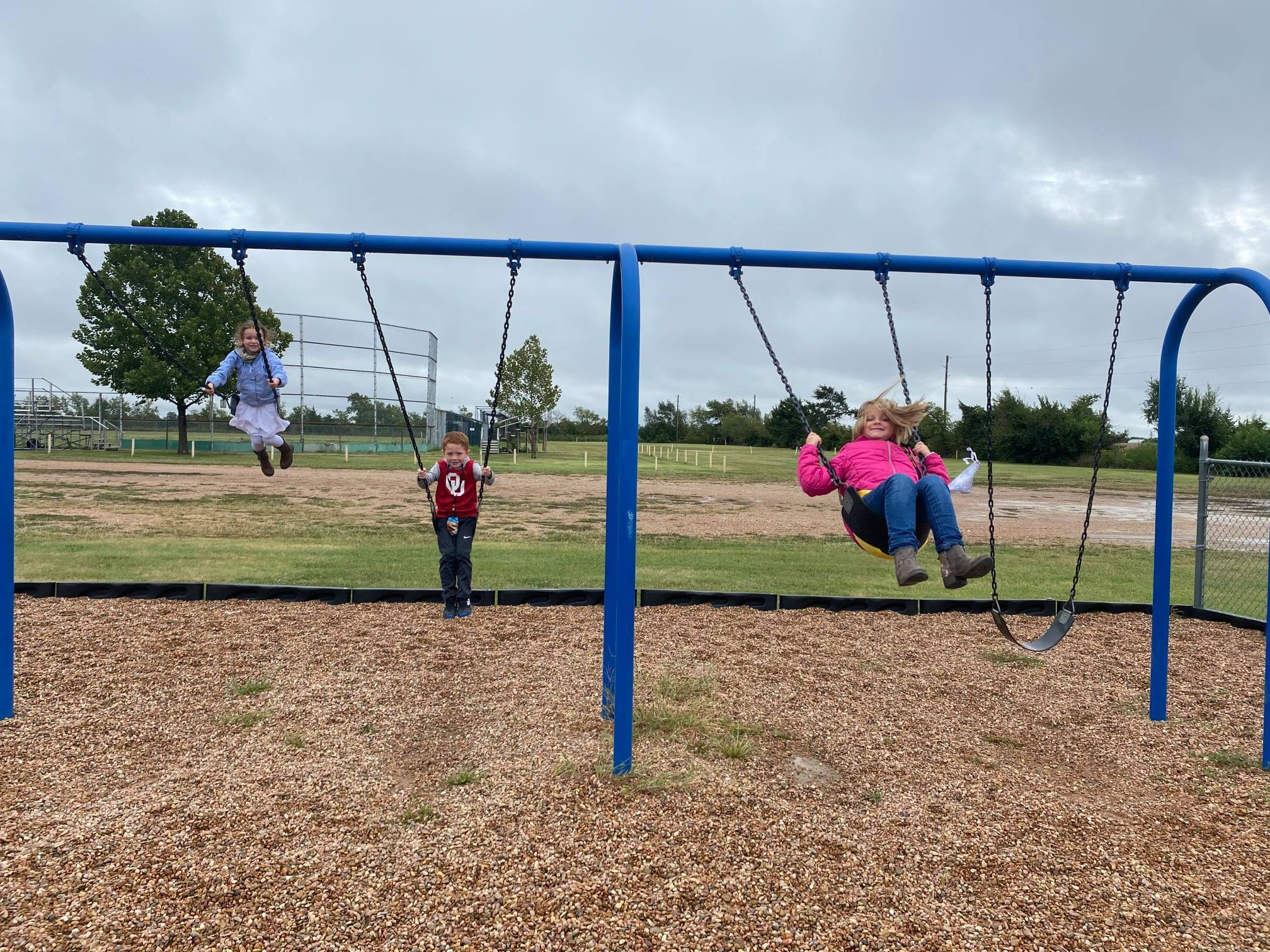 Kids Swinging on Playground