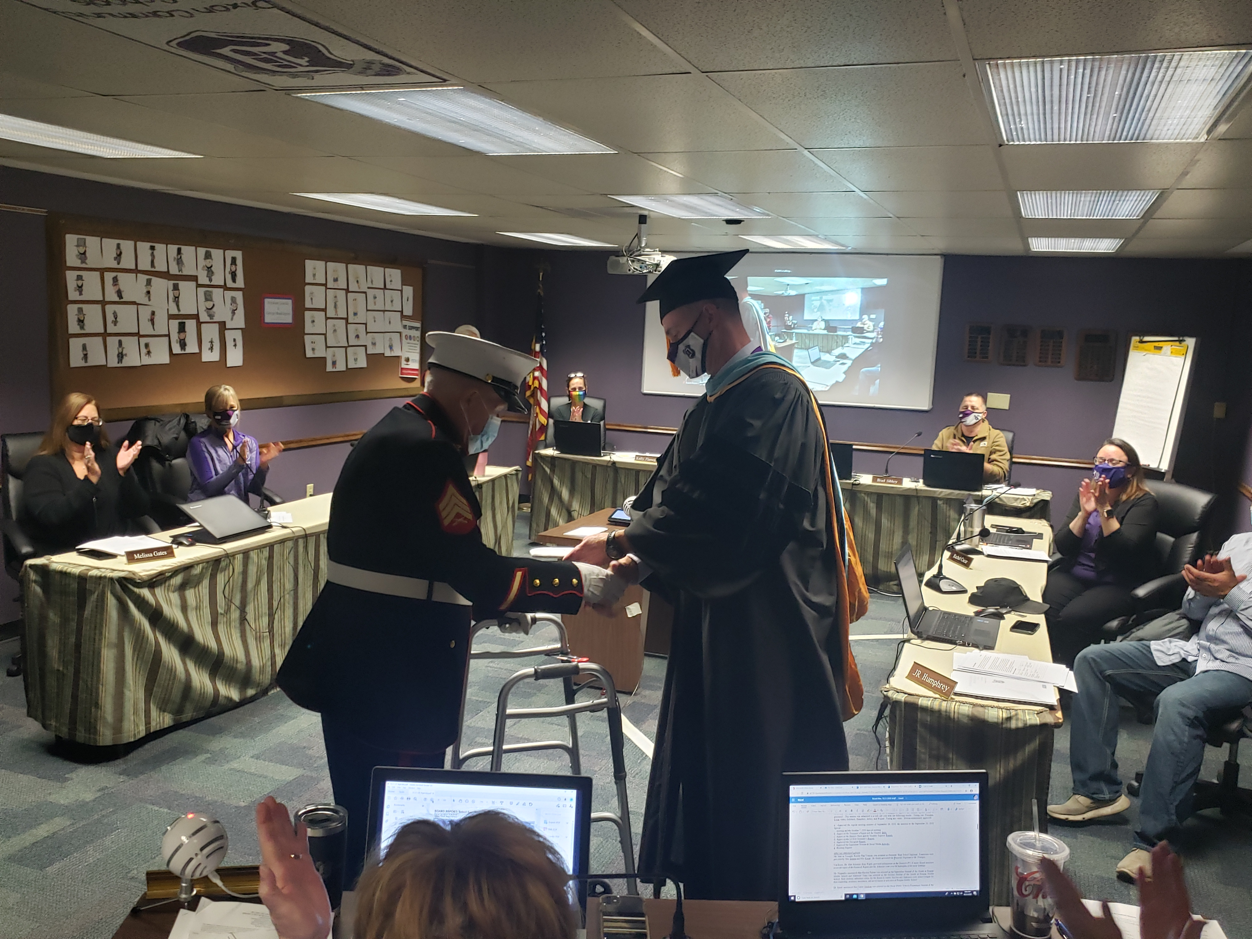 Marvin Younger receives his diploma from Dr. Grady
