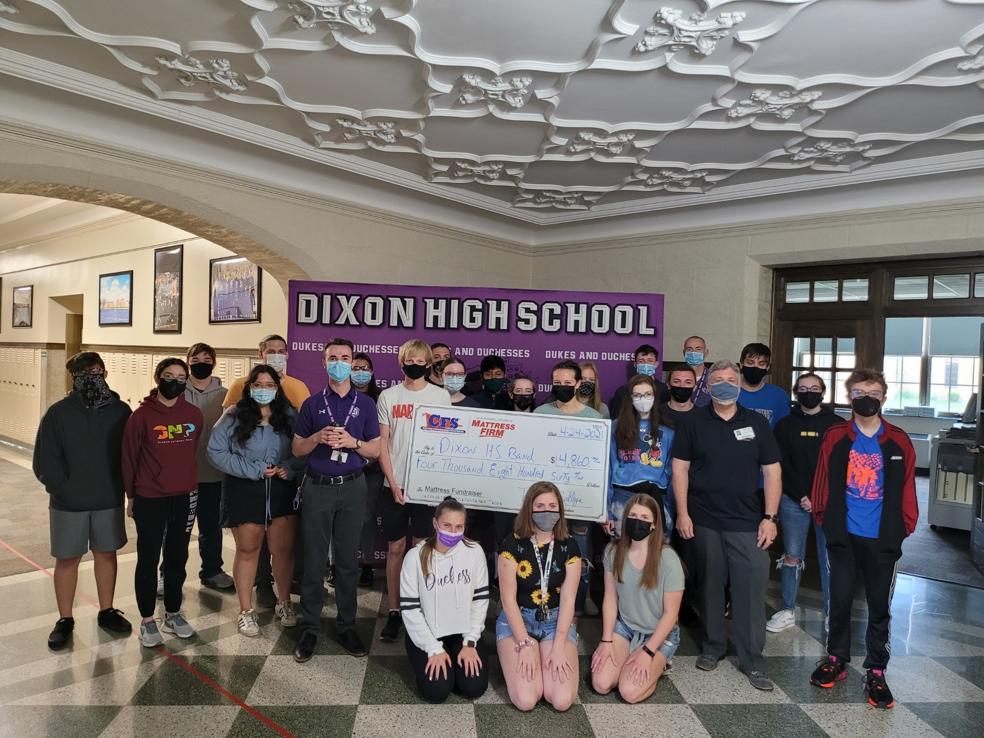 Photo of students and large check presentation