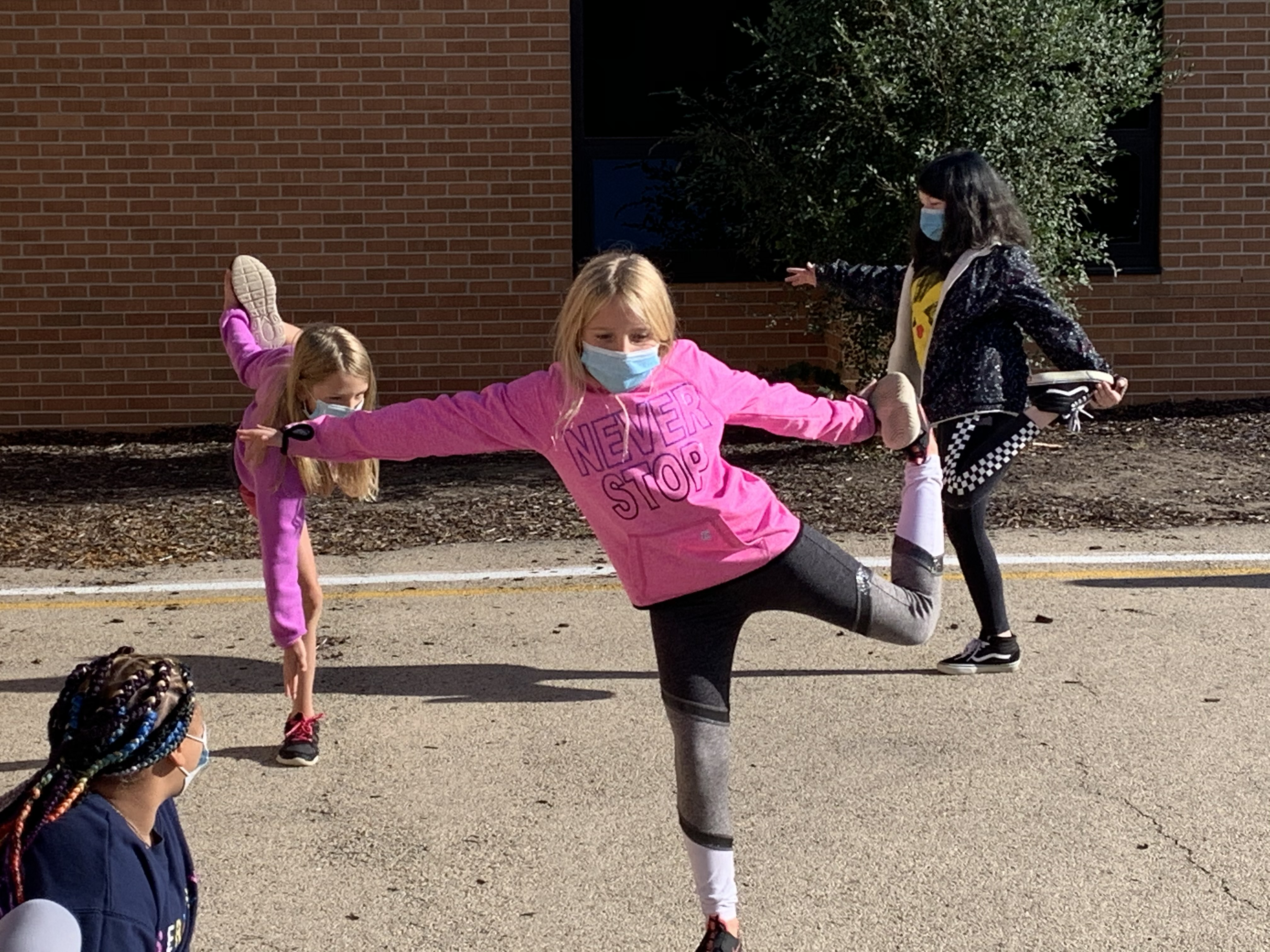 Playground Yoga with Mrs. Scott's class