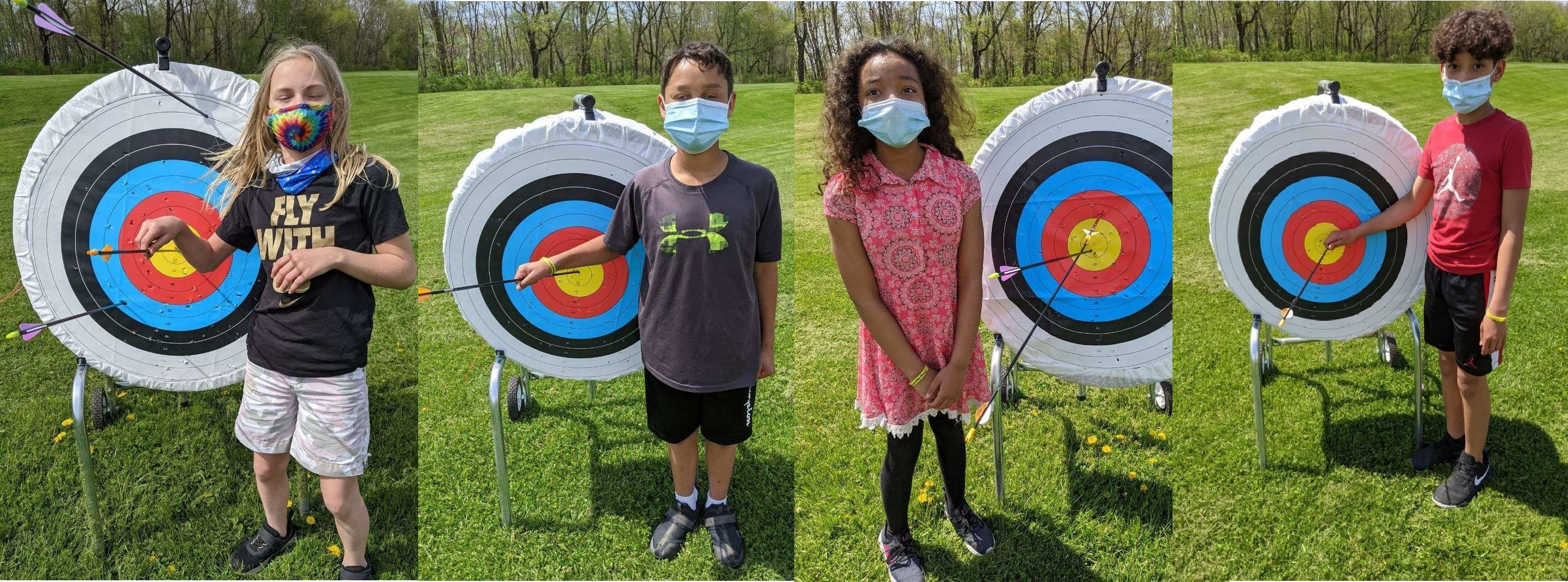 Photo of students with archery target