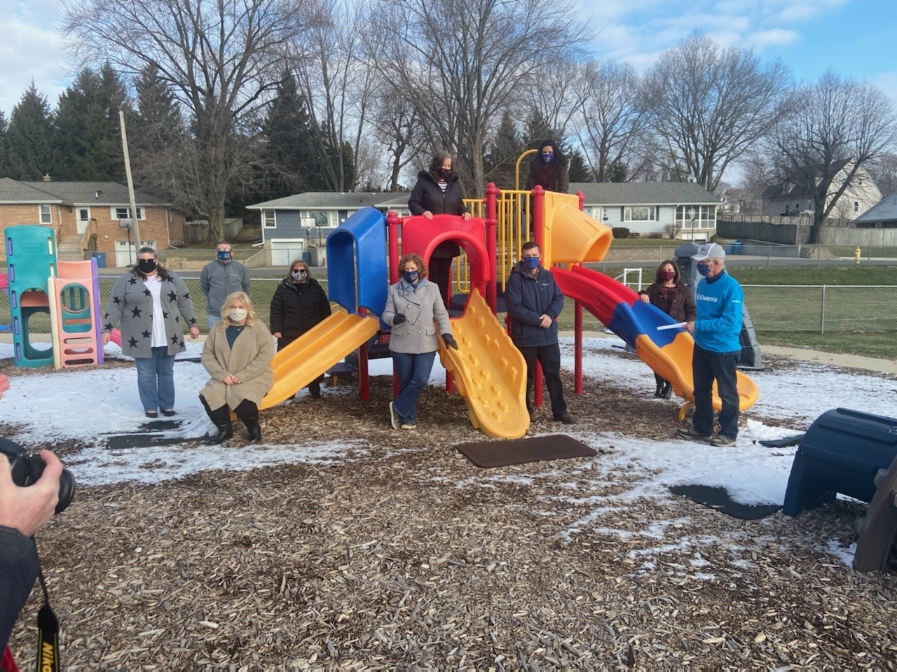 Photo of people with playground equipment