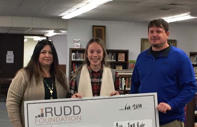 The winning student of the scholarship with her parents