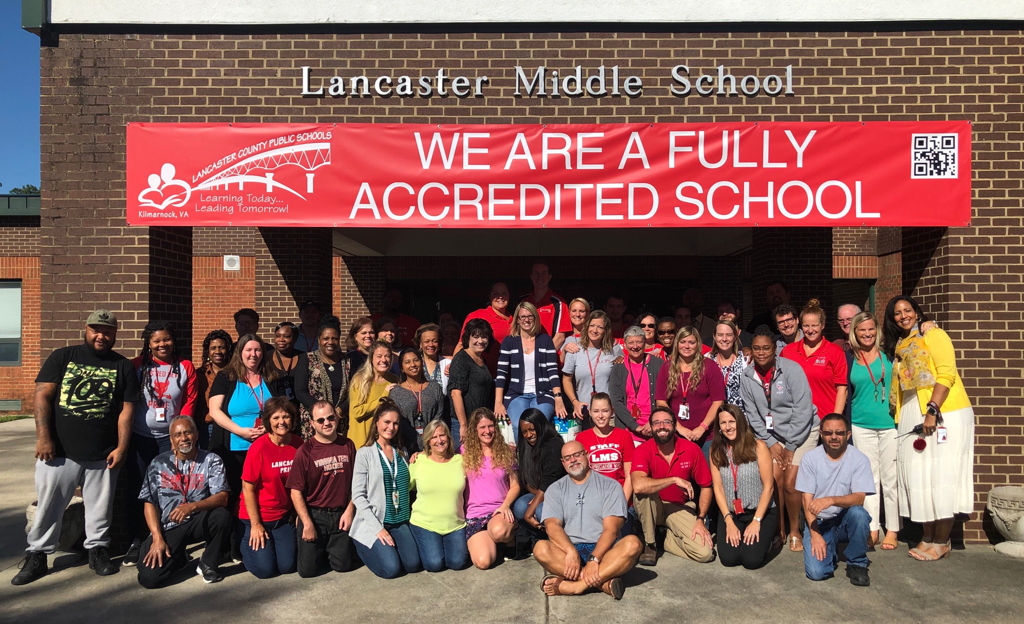 picture of lms staff in front of the building