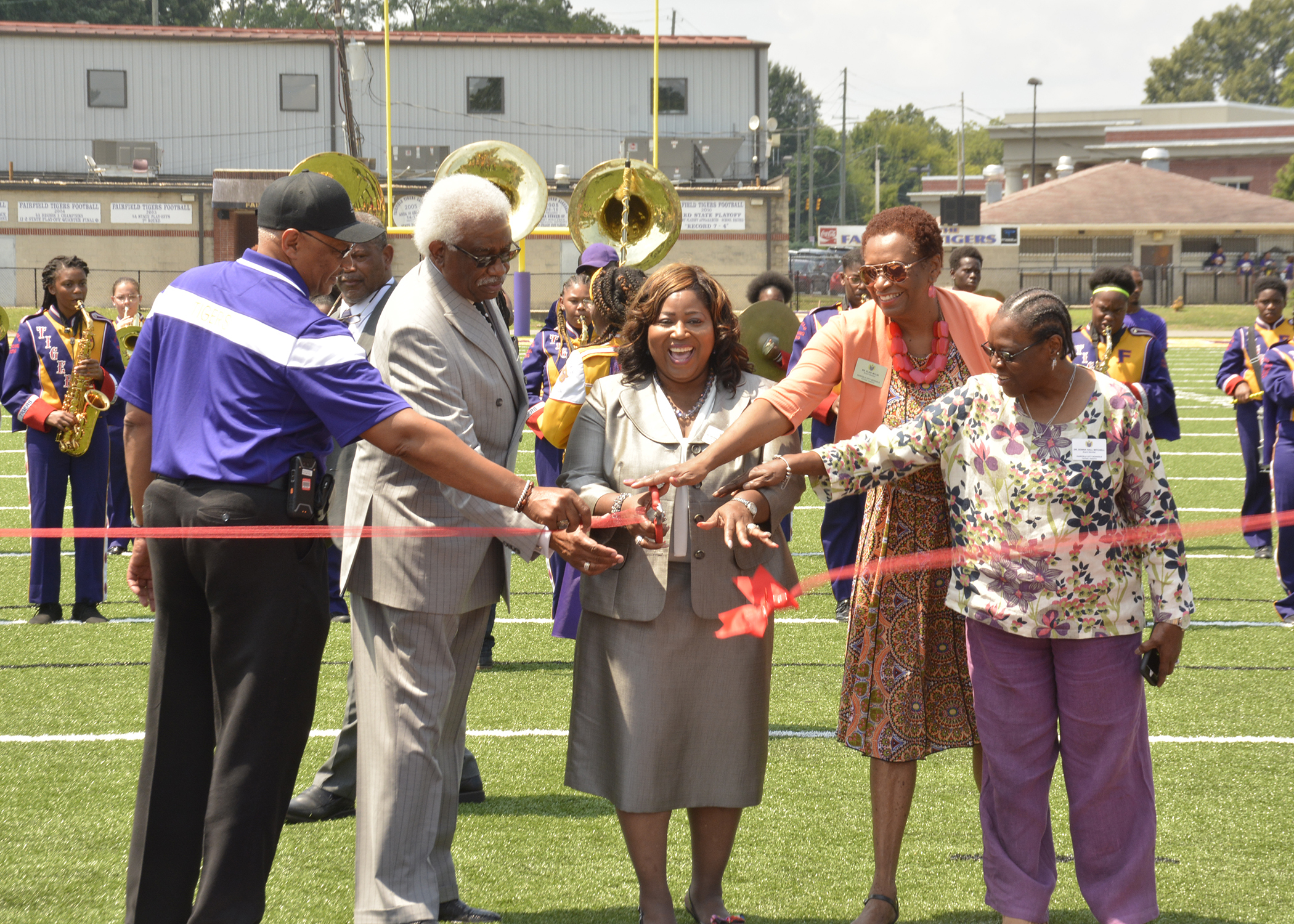 Dr. Thompson, Board cut ribbon on new turf (August 2019)