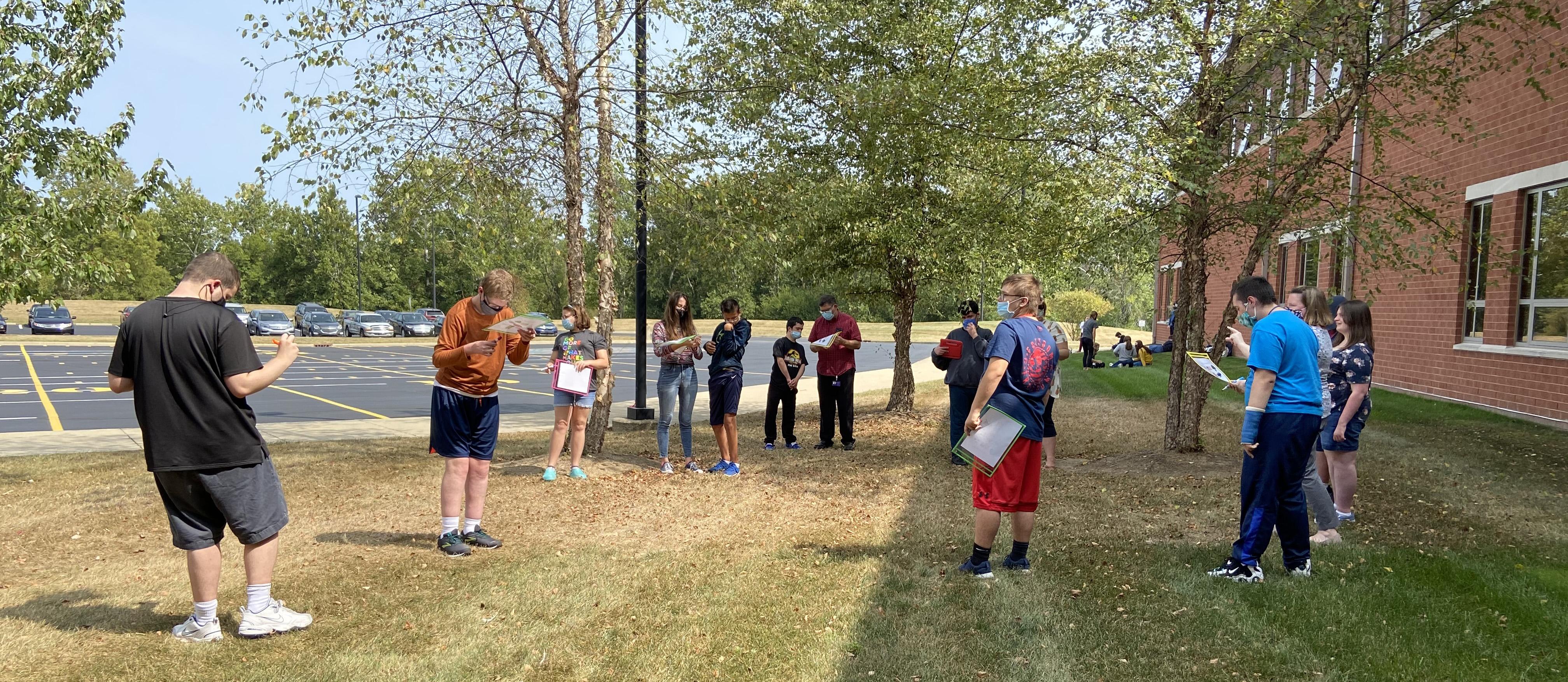 Miss B's class doing an outdoor scavenger hunt