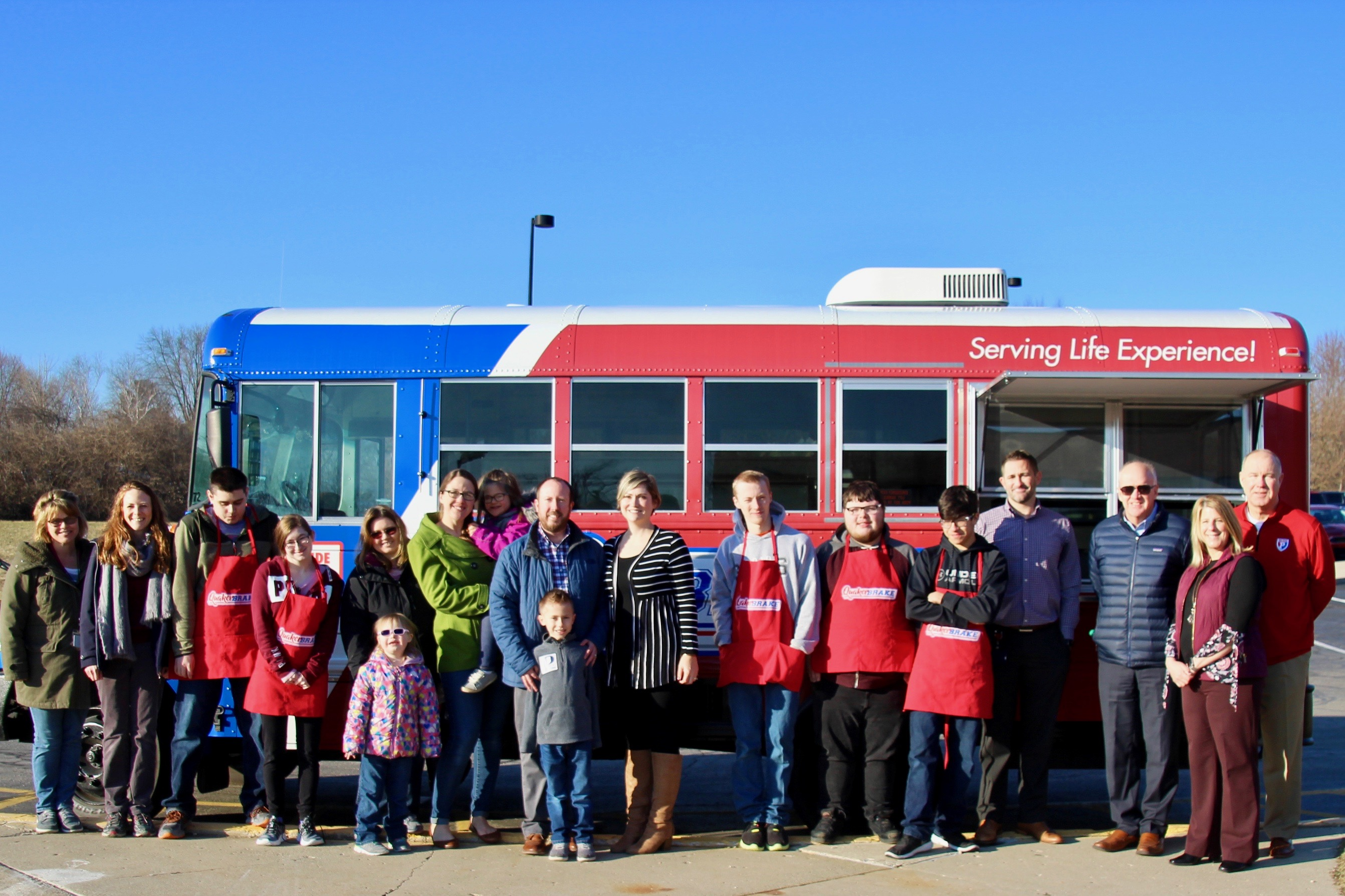 photo of parents and students in front of a food truck