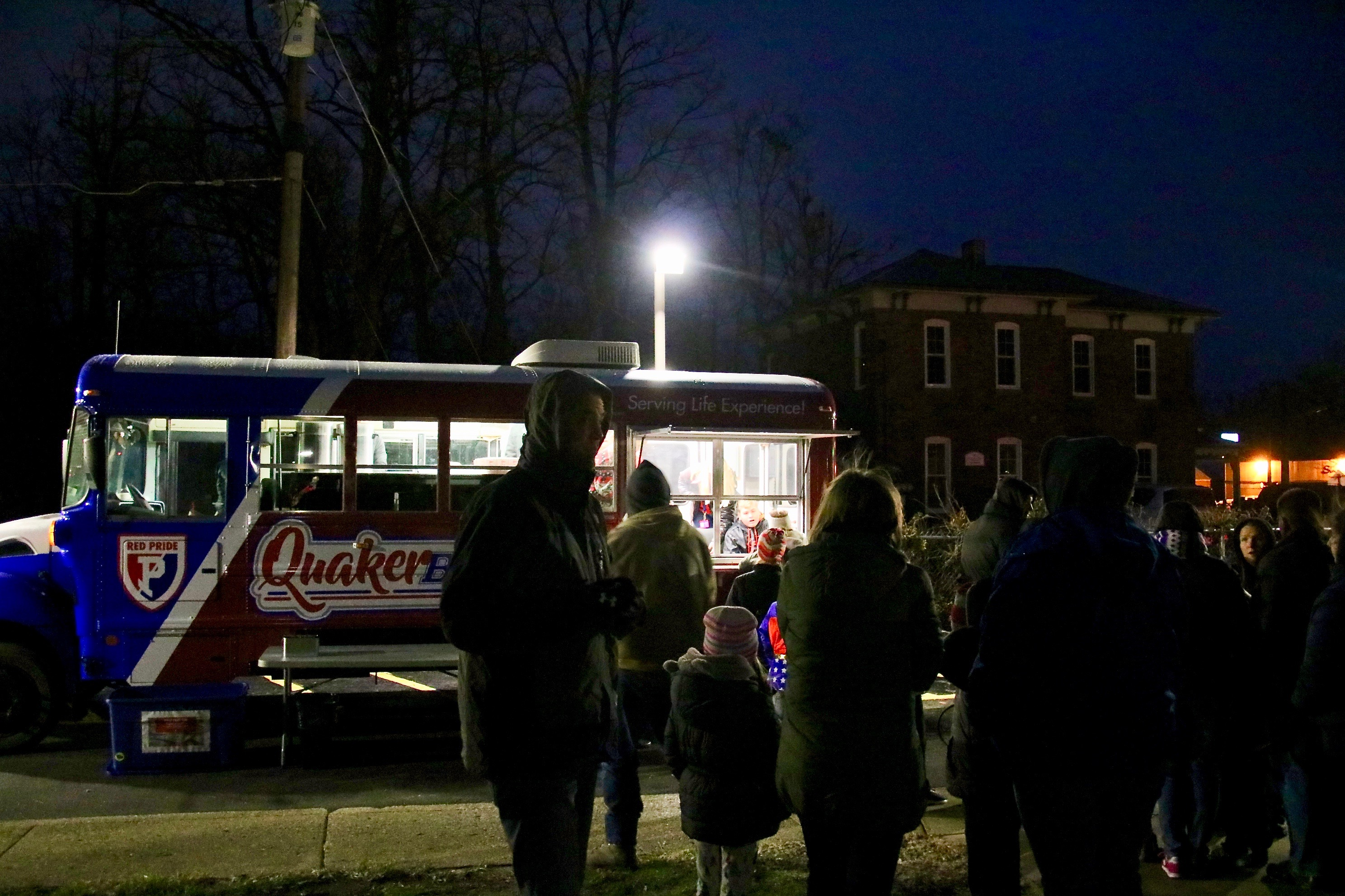 photo of people standing in line at a food truck