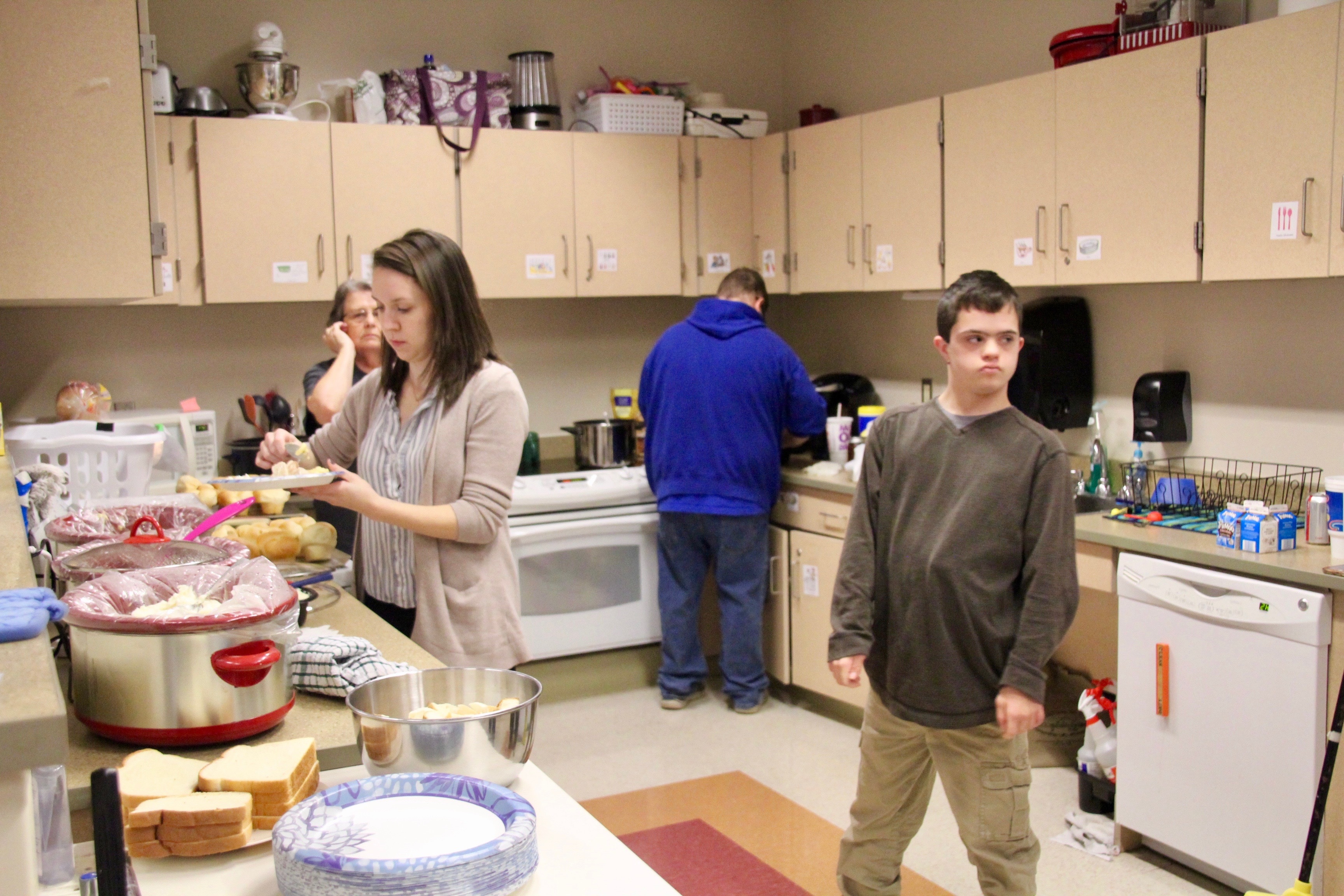 photo of people working in the food pantry