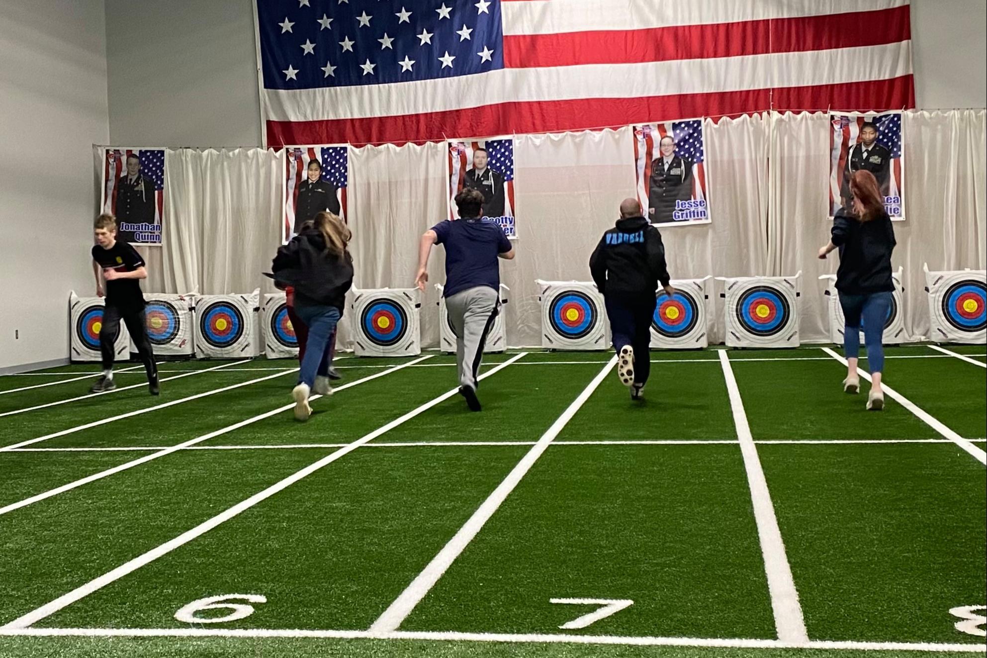 Students running in JROTC's new indoor training facilities