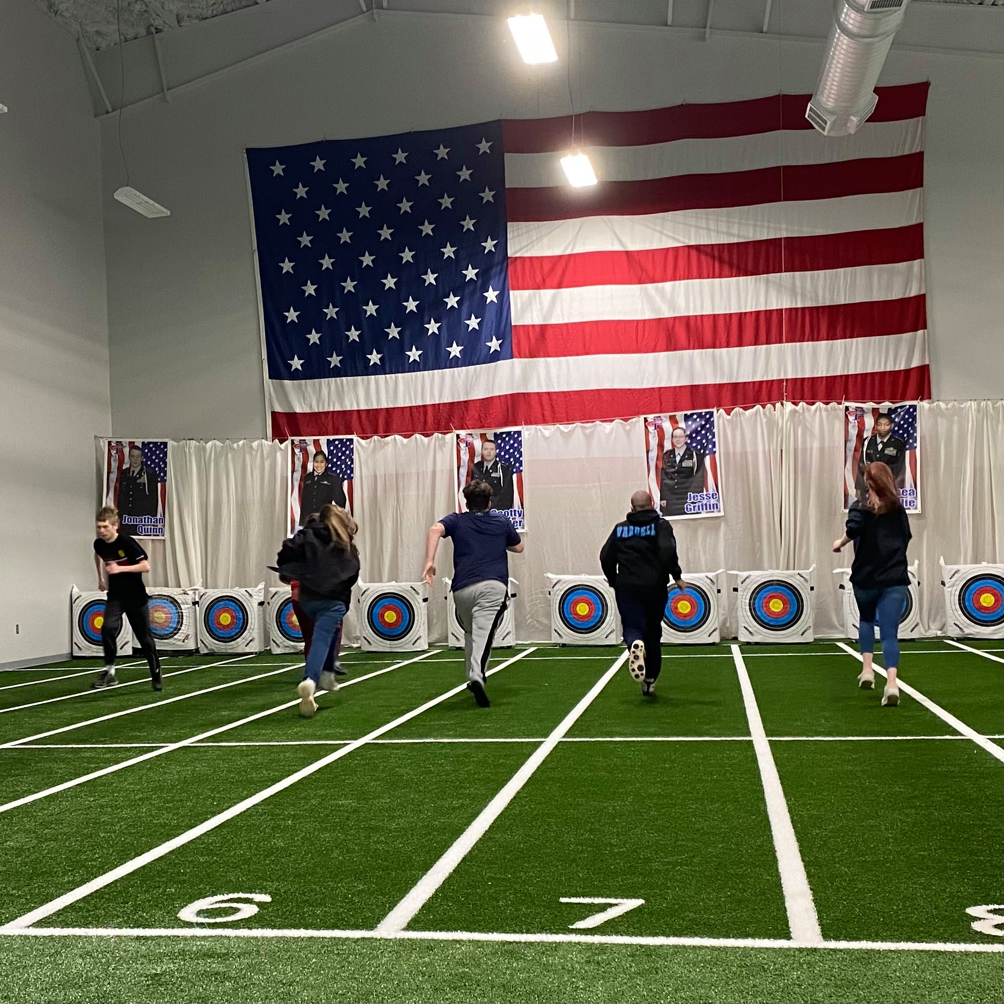 students run on the indoor track in the new JROTC facility
