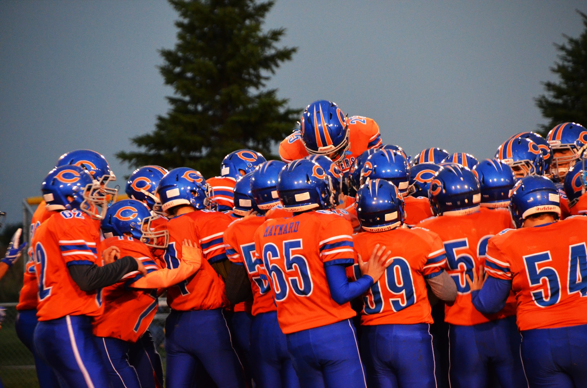 Group picture of the Canby Football Team Before the Game Huddled Up