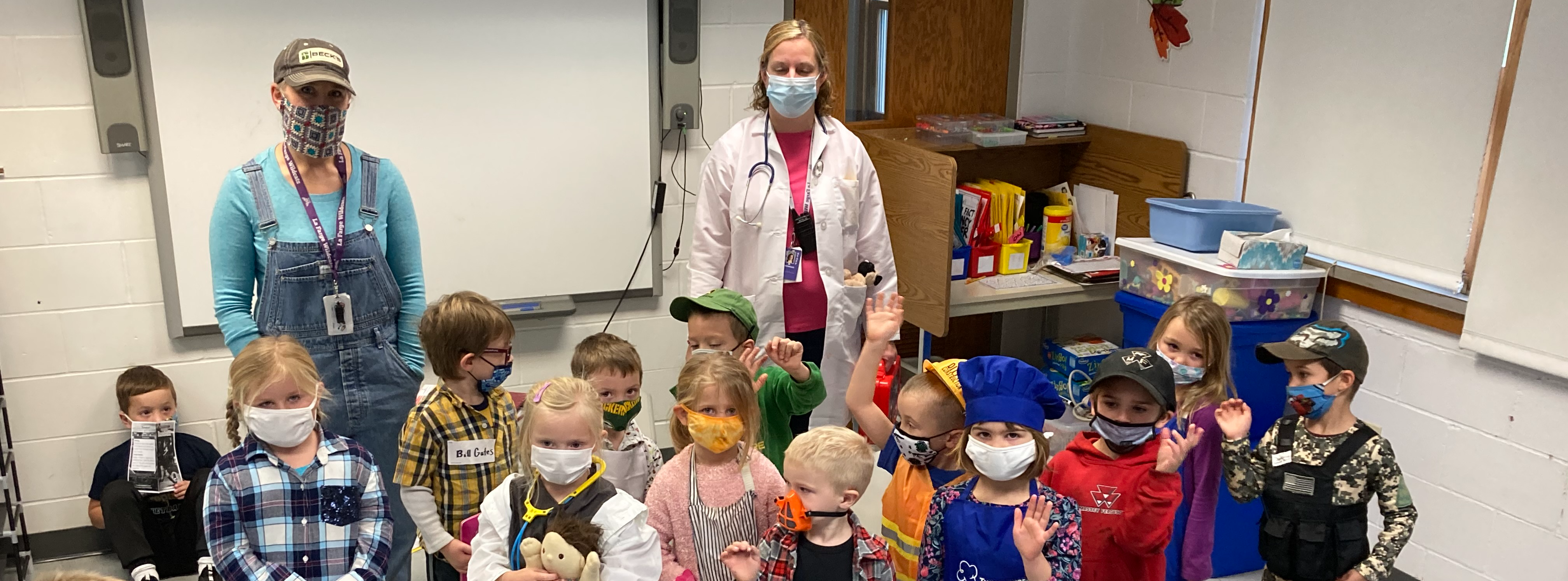 Students wearing masks in classroom with nurse