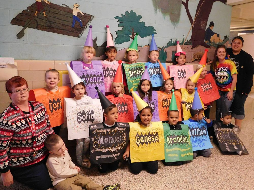 Photo of the students dressed up as color crayons