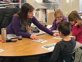 Teacher educating her students
