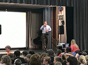 Principal addressing students
