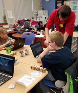 Kids working on laptops