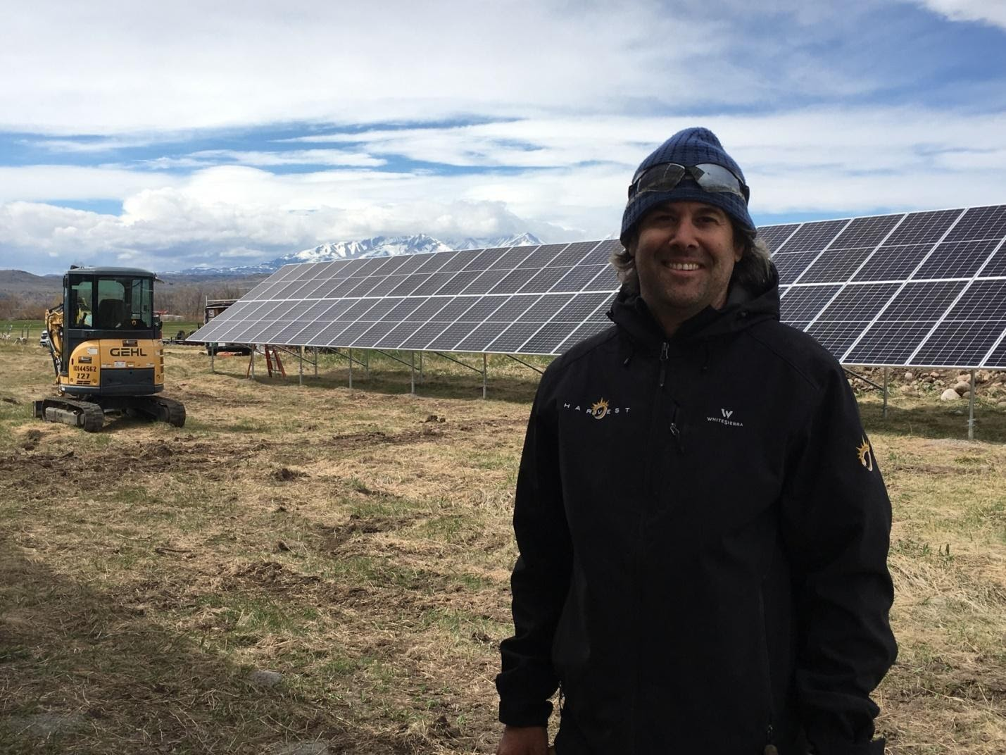Person standing in front of solar panels