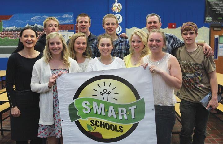 """Group of people holding """"Smart Schools"""" banner"""
