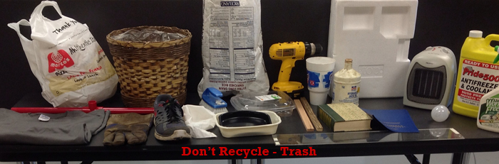 A picture of examples of trash, not recycling materials