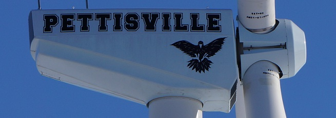 A closer up picture of the side of the windmill with Pettisville and logo on it