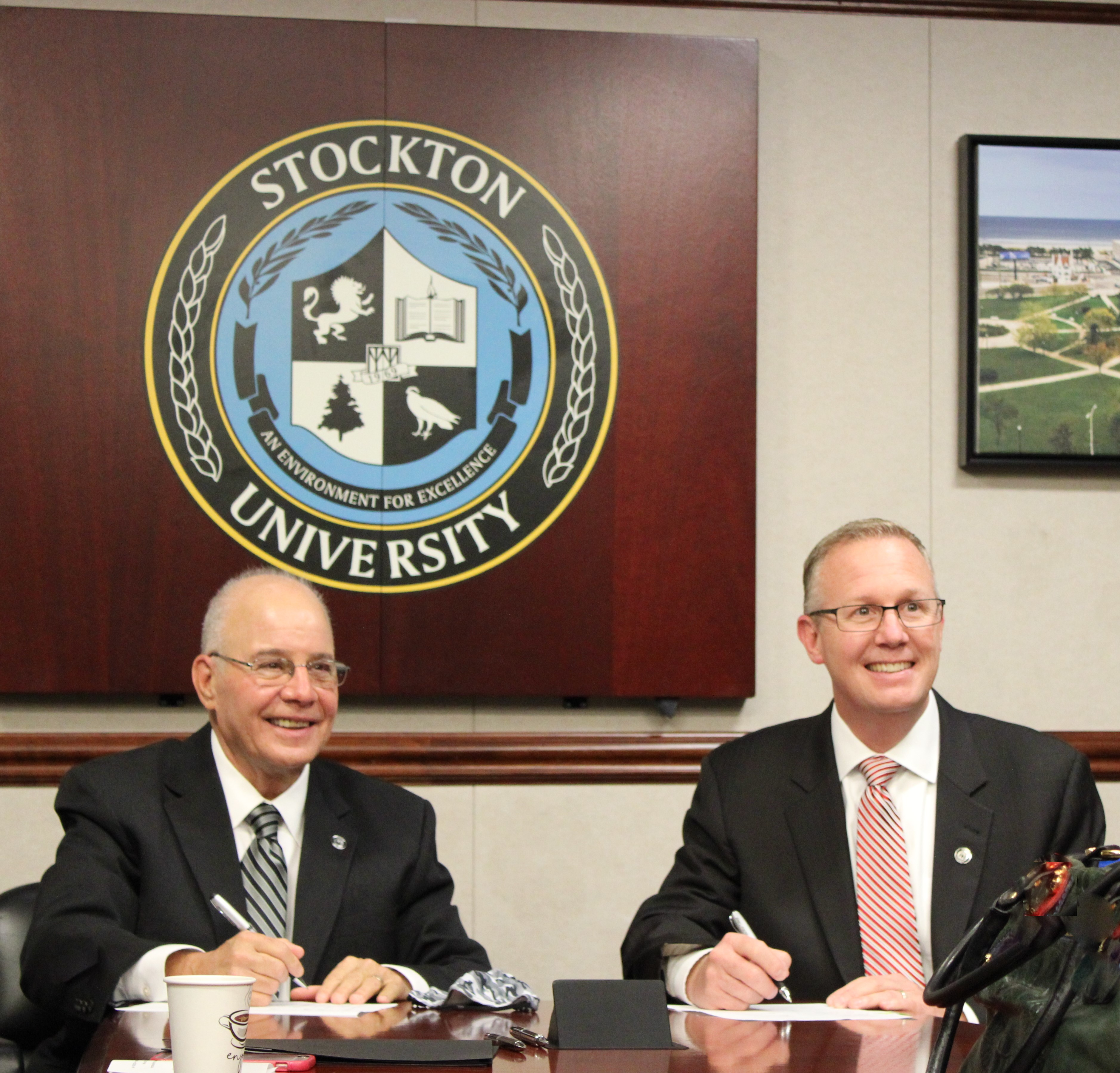 Dr. McBride signing the agreement with Stockton University for ECHS with university president, Dr. Kesselman
