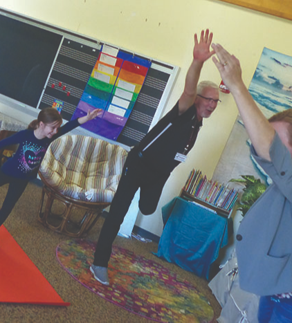 Board Member Phil Trautman participates in Yoga during Board Day in Our Schools