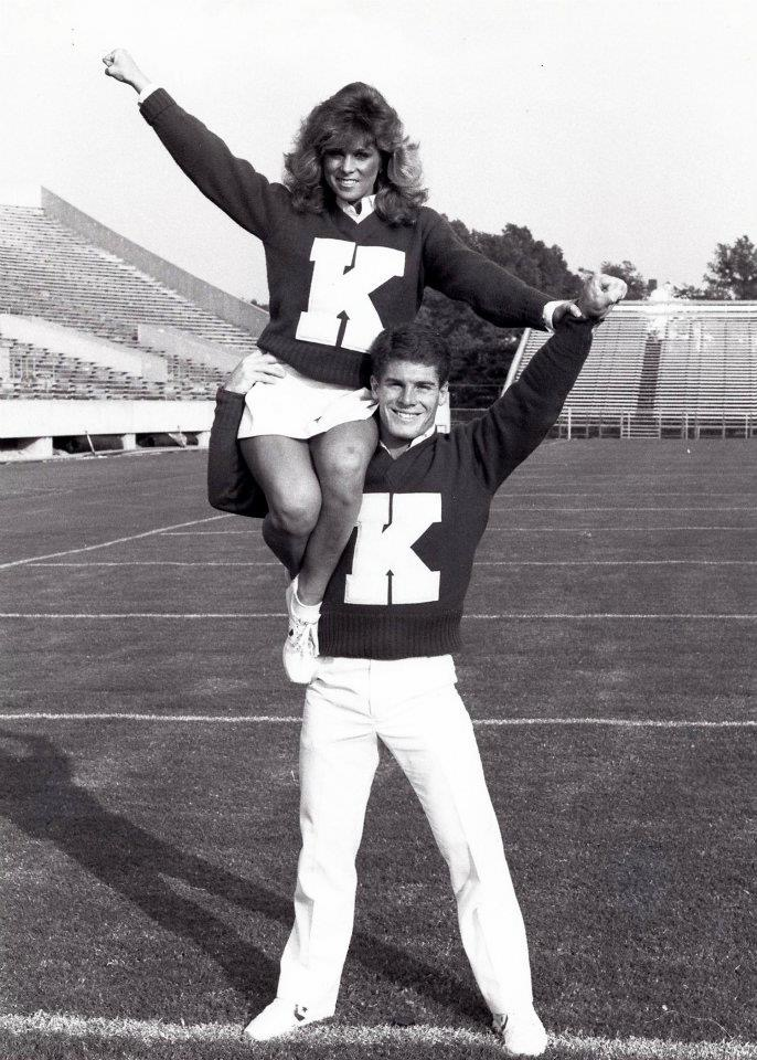 A photo of Dale Baldwin and a cheerleader.