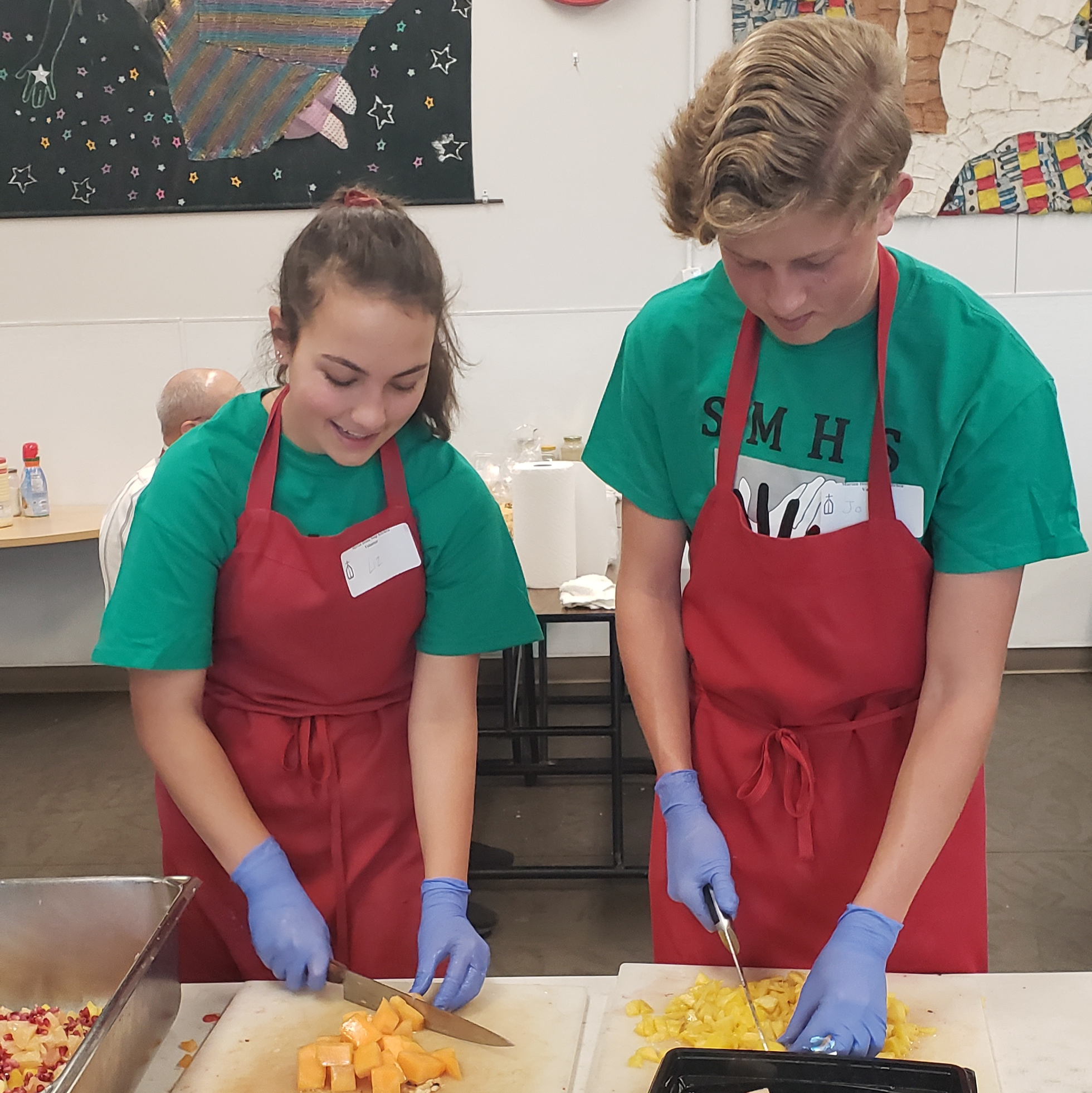 2 students cutting up food