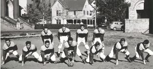 black and white photo of the football team from decades ago