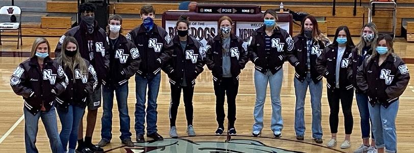 Team standing on basketball court