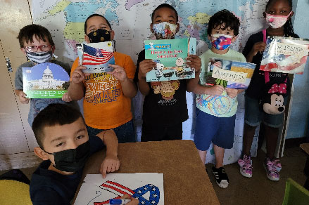 students holding books about september 11th
