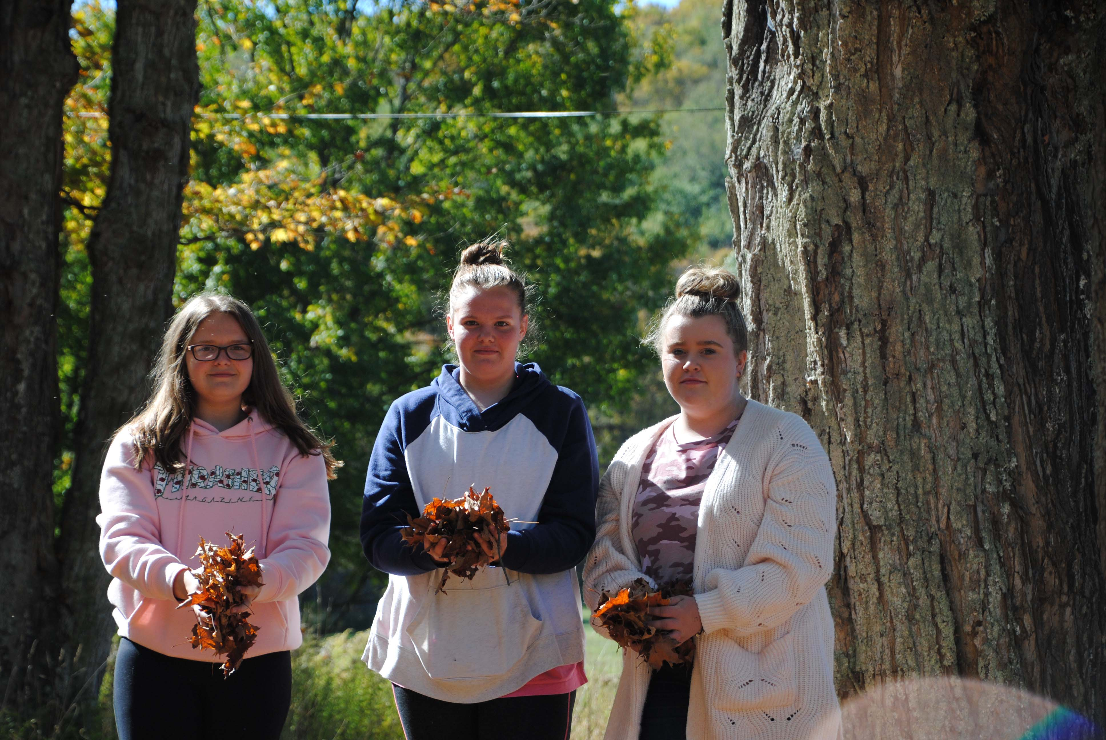 Allegany State Park visit - three girls with leaves