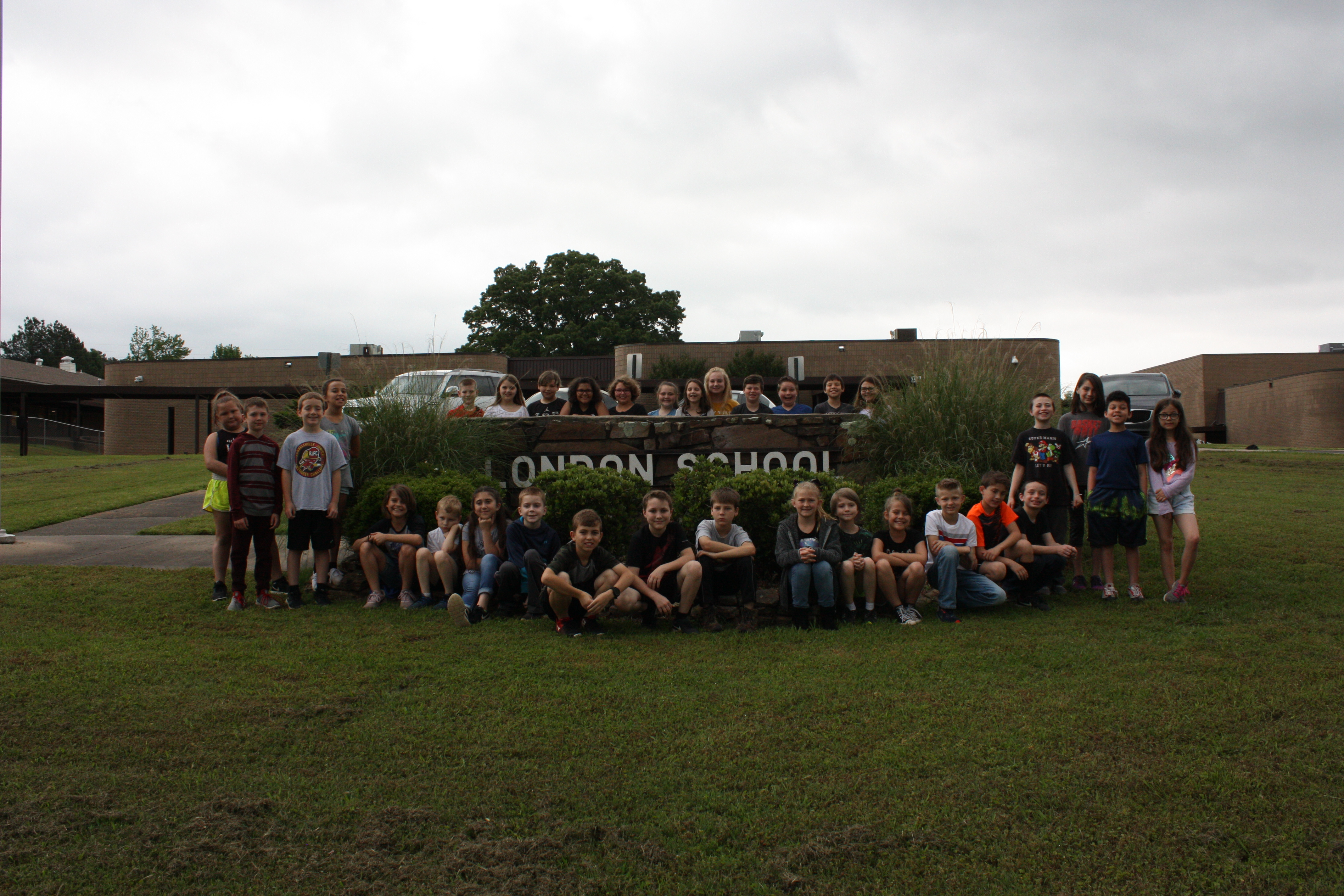 Photo of the students posing outside the school's building