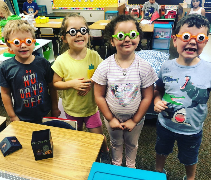 Photo of a group of students with funny looking glasses