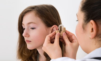 teen with hearing aid