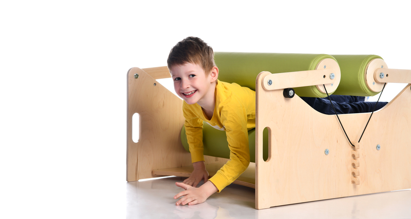 smiling boy in exercise set for persons with locomotor disorder