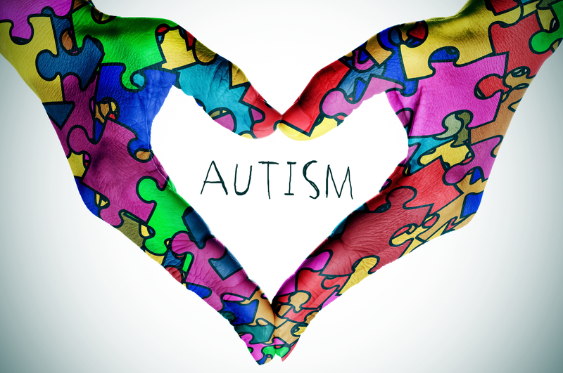 Autism with puzzle rainbow hands