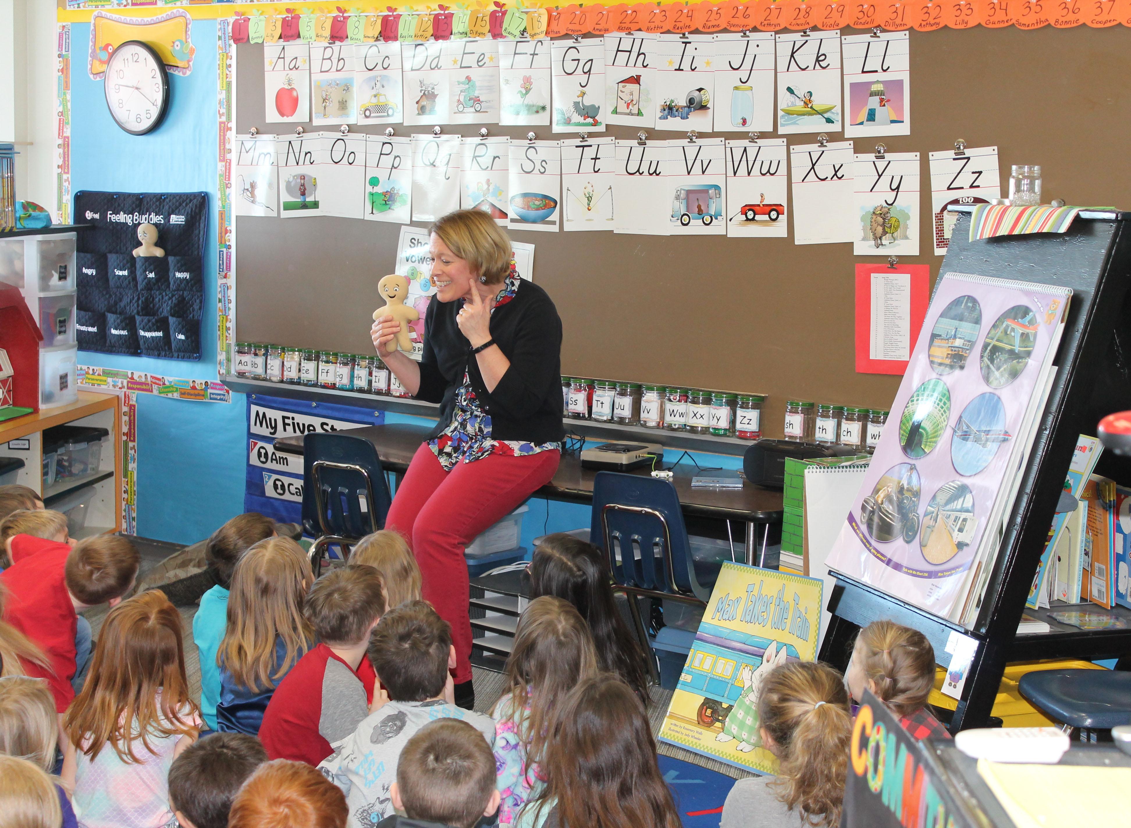 A photo of a teacher in a classroom.