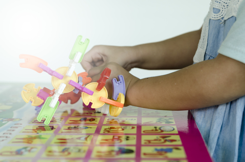 A photo of a kid playing.
