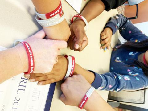 A photo of the students with their wristbands.