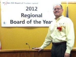 Sam Saldivar, Jr. in front of 2012 Regional Board of the Year sign