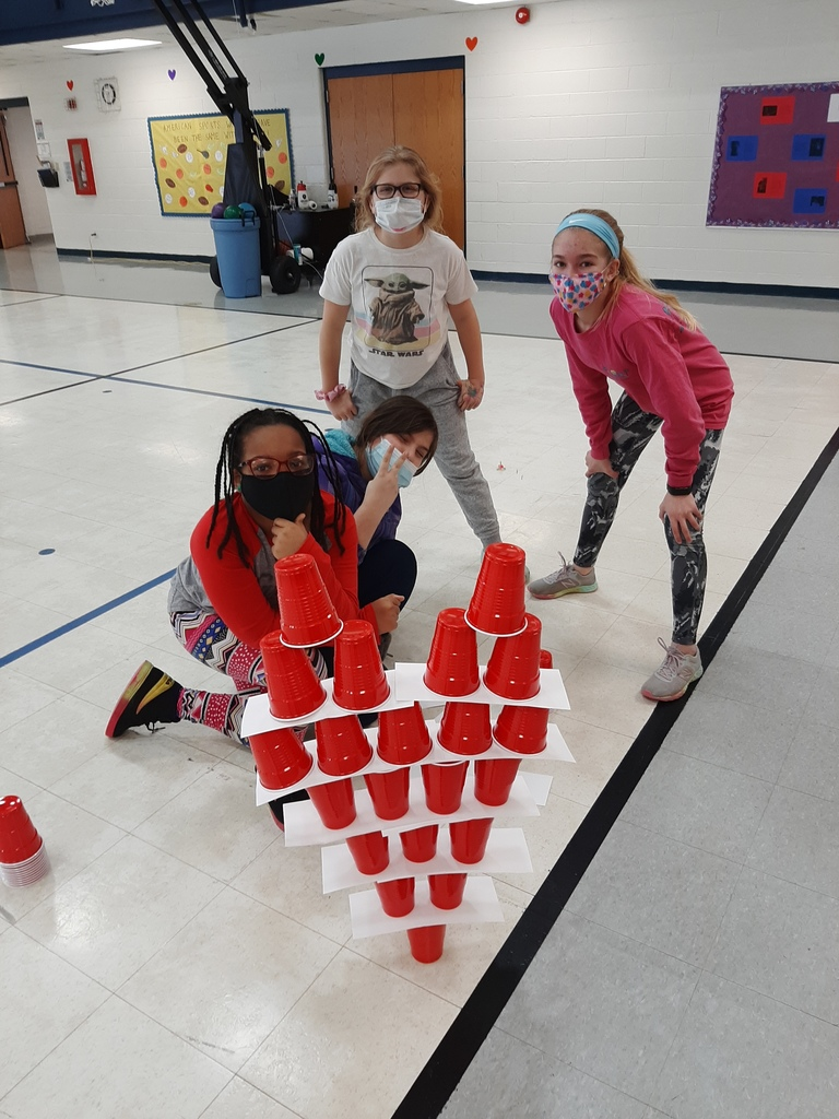 Students building cup tower