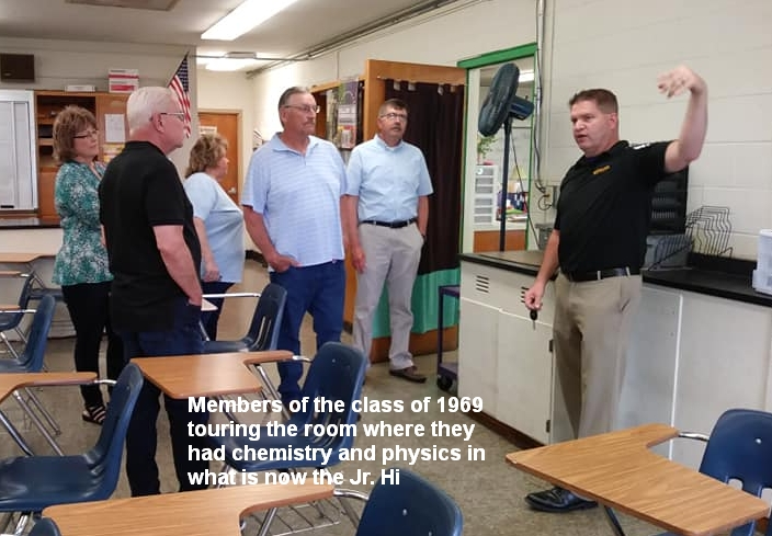 Members of the class of 1969 touring the room where they had chemistry and physics in what is now the Jr. High