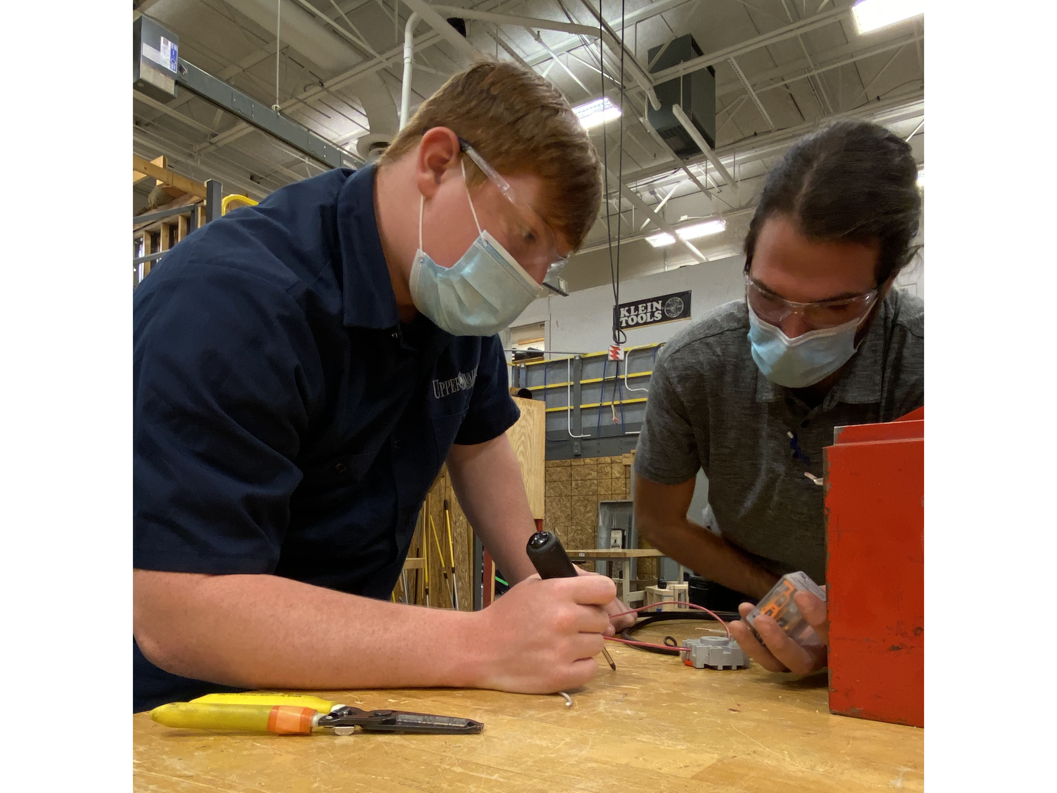 Electrical Trades Students working in their lab