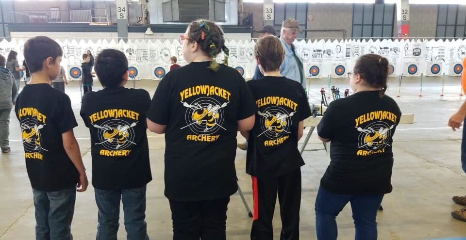 Archery students show off the team t-shirt