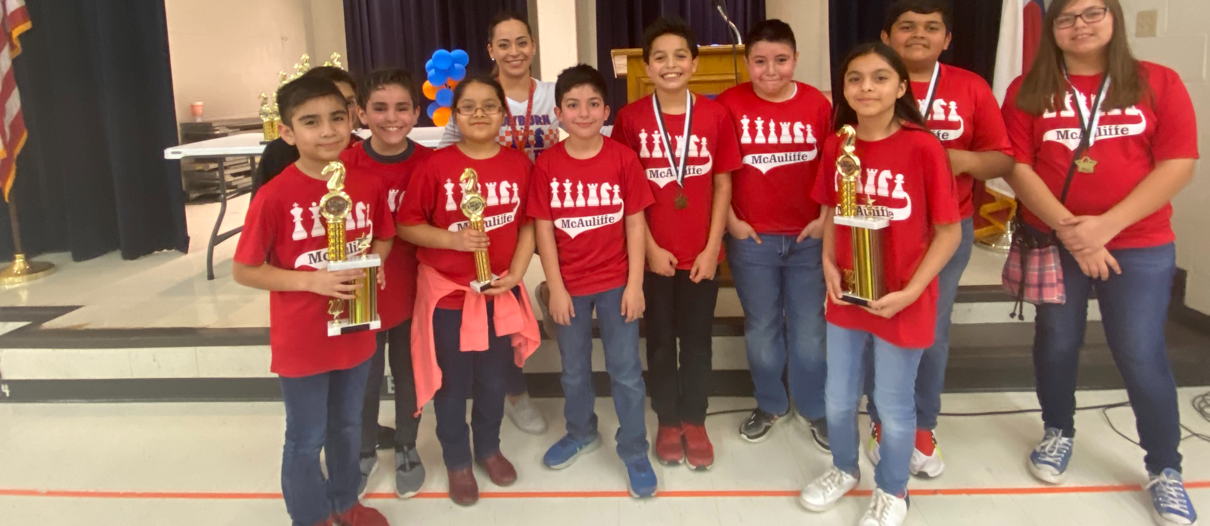 chess team with trophies