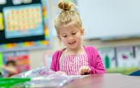 Young girl working in class